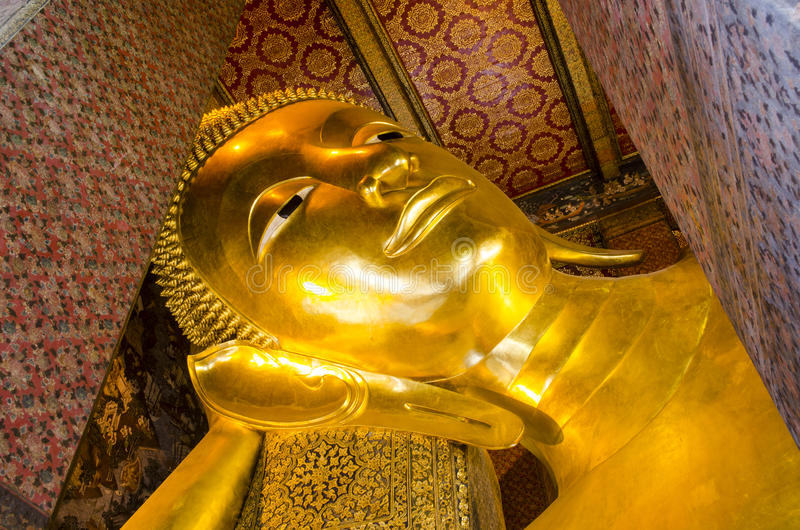 Reclining Buddha gold statue face. Wat Pho, Bangkok, Thailand stock image