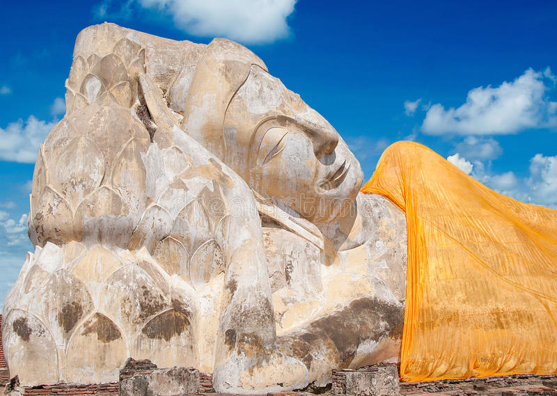 Reclining Buddha status. On blue sky background stock image