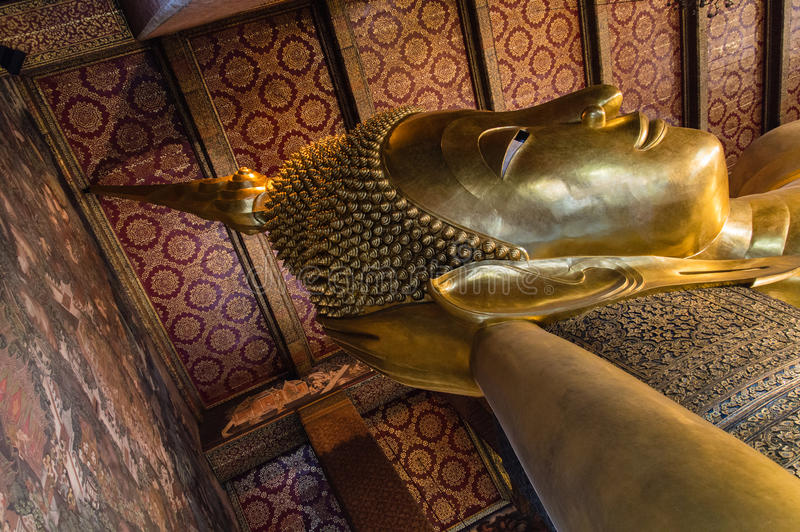 Reclining buddha within the Wat Pho in Bangkok stock photography
