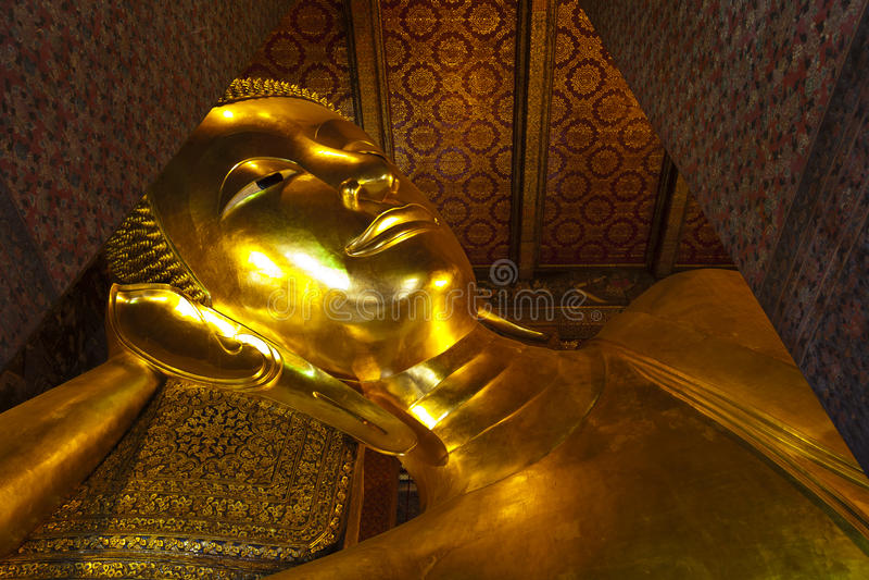 Reclining buddha Wat Pho in Bangkok Thailand. stock photo