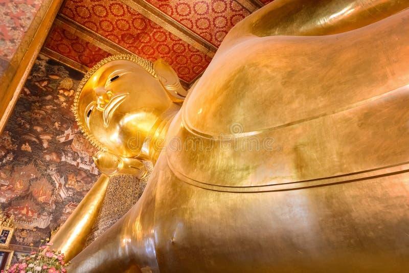 The Reclining Buddha at Wat Pho (Pho Temple) in Bangkok royalty free stock photo