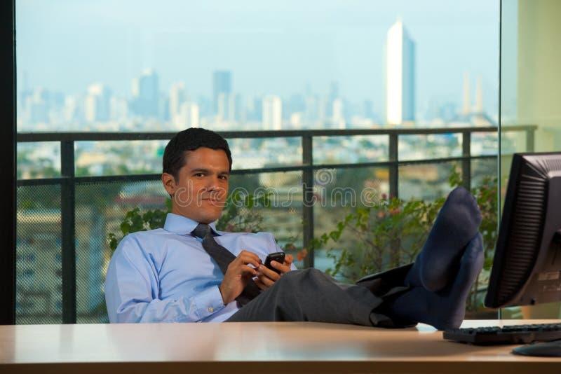 Reclining Hispanic Executive Office View Skyline stock photos