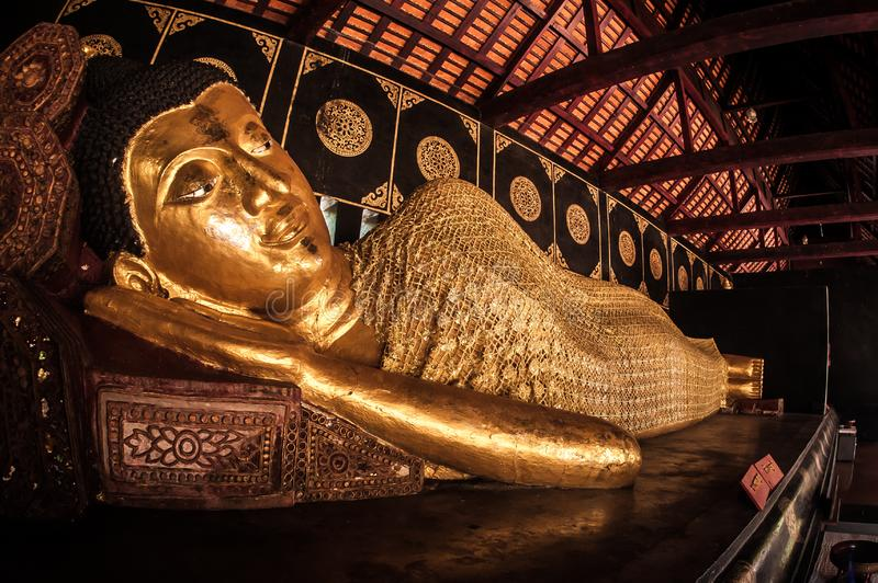Reclining lying Buddha statue at Buddhist temple in Thailand royalty free stock photo