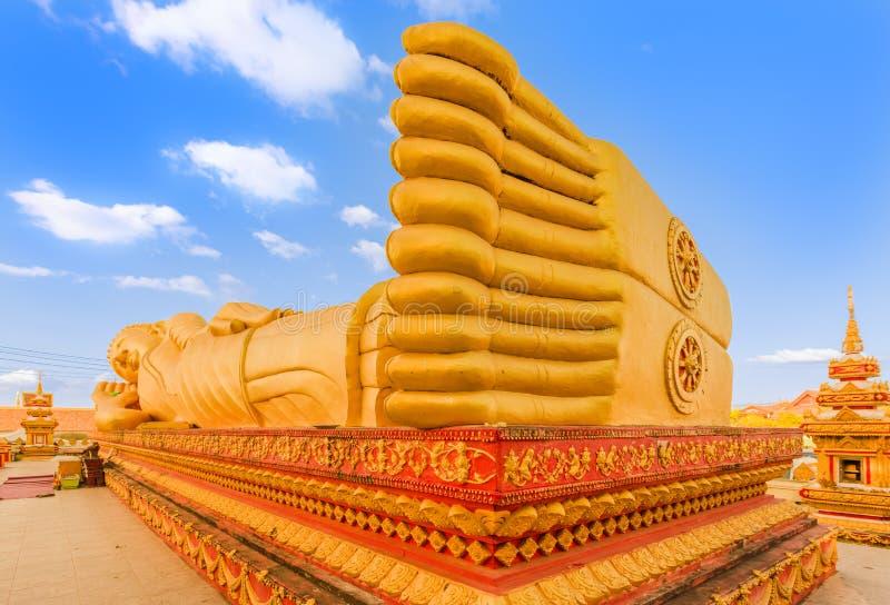 Reclning Buddha. Vientiane, Laos. Reclning Buddha at Pha That temple. Vientiane, Laos royalty free stock photography