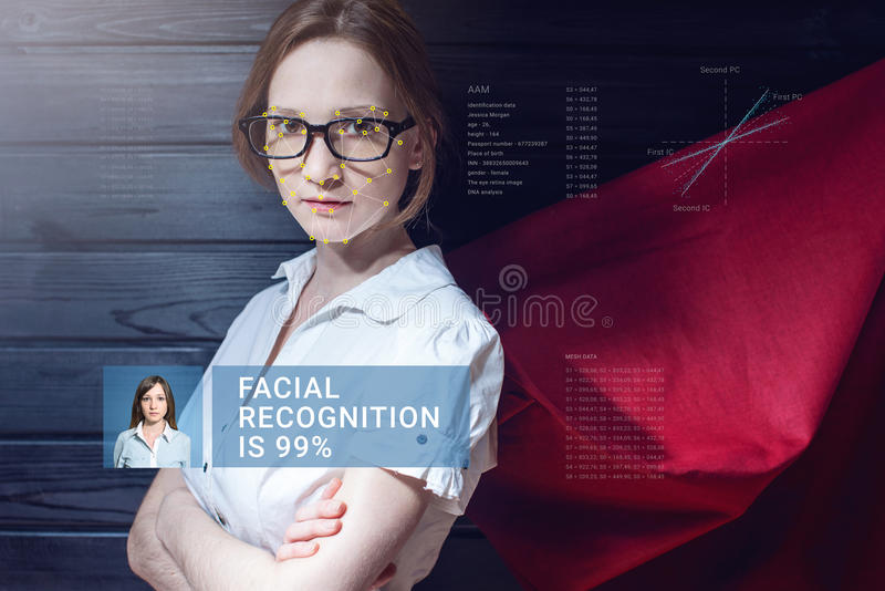 Recognition of female face. Biometric verification and identification. Recognition of a female face by layering a mesh and the calculation of the personal data royalty free stock photo