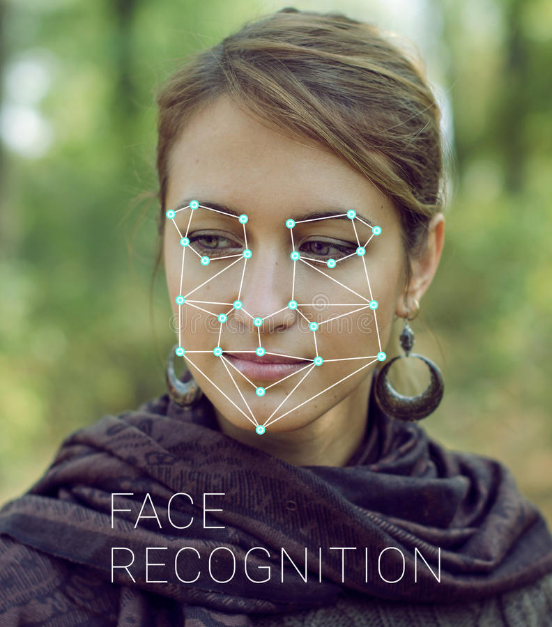 Recognition of female face. Biometric verification and identification. Recognition of a female face by layering a mesh and the calculation of the personal data stock photo