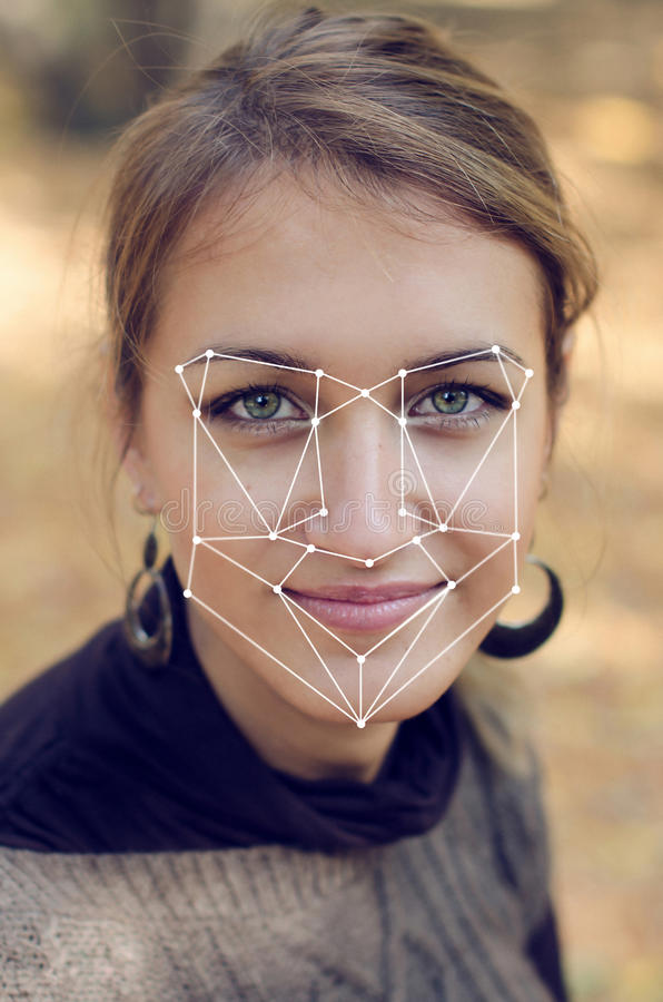 Recognition of female face. Biometric verification and identification. Recognition of a female face by layering a mesh and the calculation of the personal data stock images