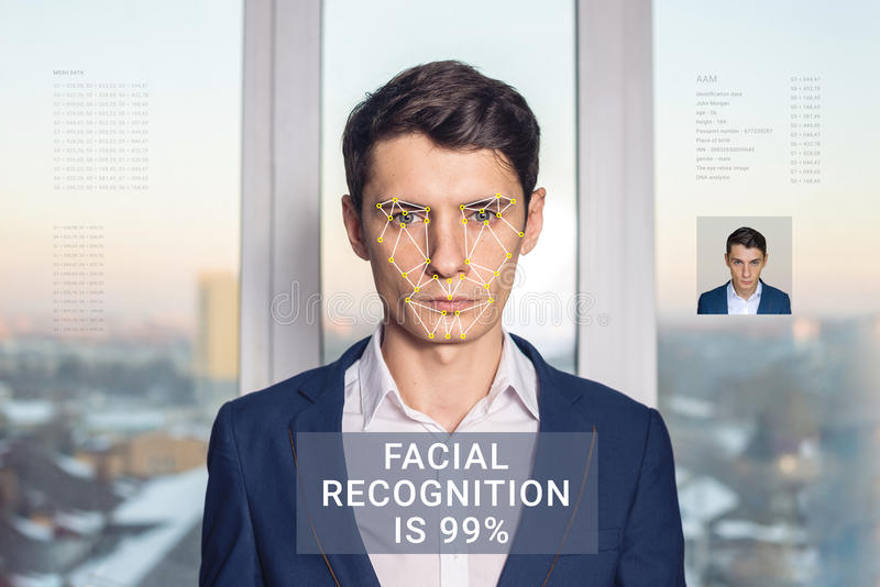 Recognition of male face. Biometric verification and identification. Recognition of a male face by layering a mesh and the calculation of the personal data by stock photo
