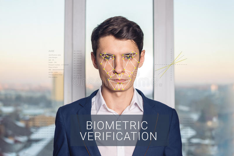 Recognition of male face. Biometric verification and identification. Recognition of a male face by layering a mesh and the calculation of the personal data by stock image