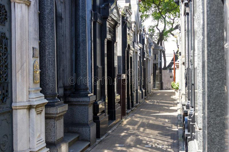Recoleta cemetery in Buenos Aires narrow passage with shadow royalty free stock photography