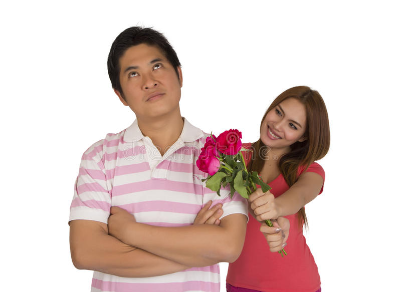Reconcile. Women reconcile men with flowers, on white background royalty free stock images