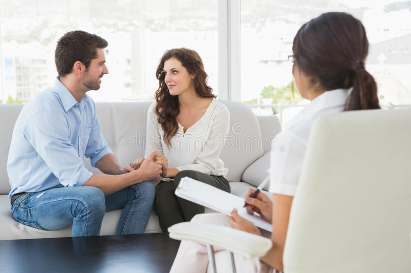 Download Reconciled Couple Smiling At Each Other Stock Photo - Image of couple, marriage: 49310912