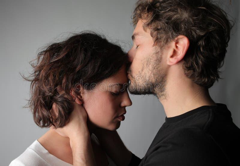 Reconciliation. A boyfriend comforts young female