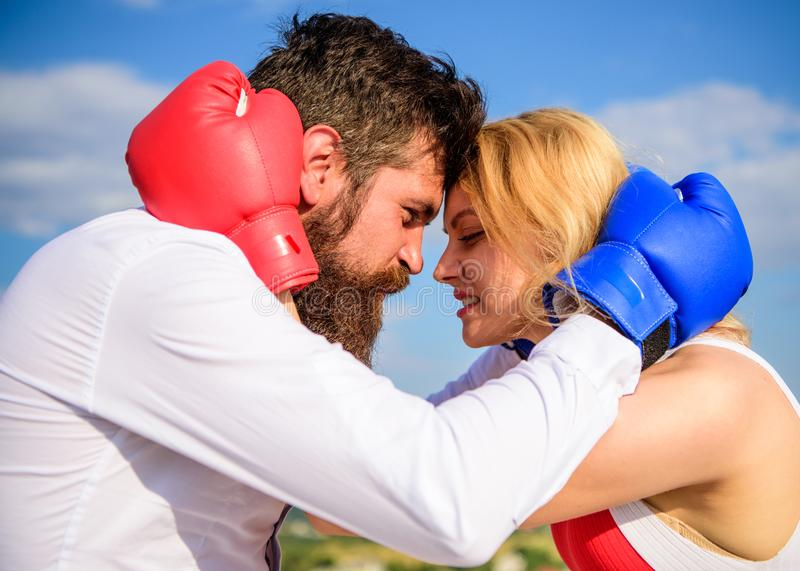 Reconciliation and compromise. Fight for your happiness. Man and girl cuddle happy after fight. Couple in love boxing. Gloves hug sky background. Quarrel and royalty free stock image