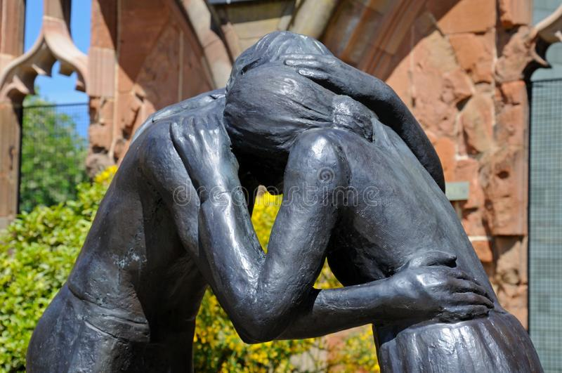 Reconciliation statue at Coventry Cathedral. stock photos