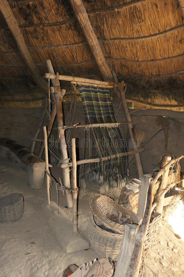 A reconstructed iron age loom in a round house located at Castell Henllys Iron Age Hill Fort royalty free stock image