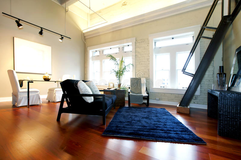 Reconstructed modern spacious living room stock image