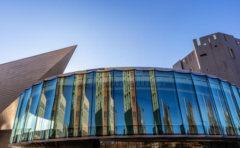 Reconstruction of Denver Art Museum in Denver, Colorado, architectural detail. New glass building with beautiful reflections located between the sharp angles stock image