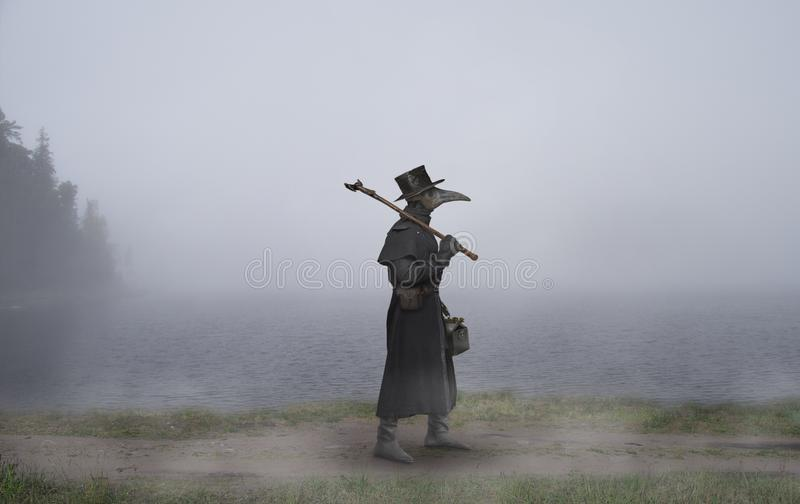 Reconstruction of the medieval scene: the plague doctor on the w stock photo