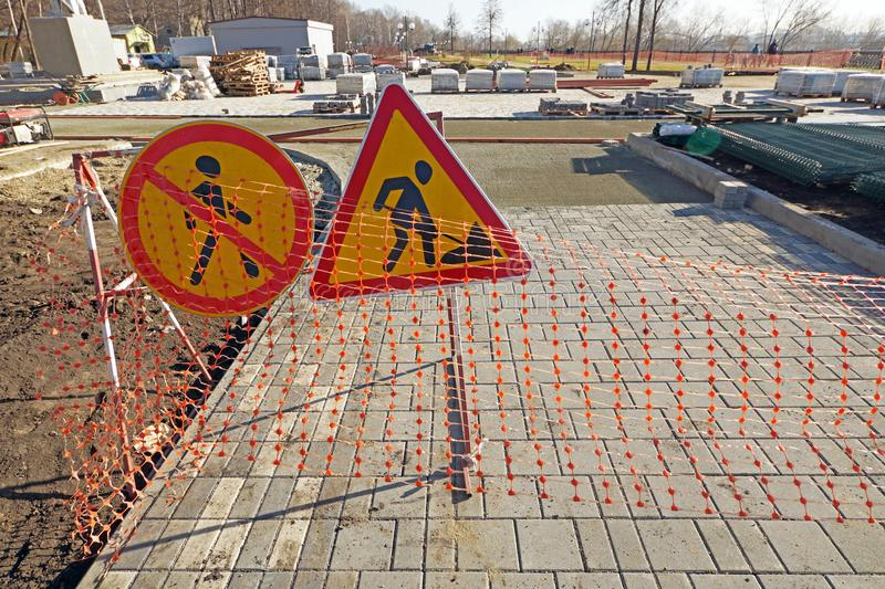 Reconstruction of pedestrian footpath. Warning signs about road works stock photography