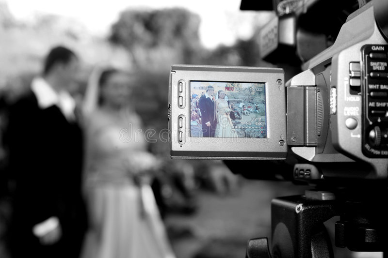 Record. Wedding being recorded with camera