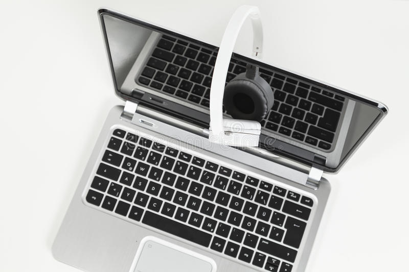 Record and headphones. On laptop stock photos