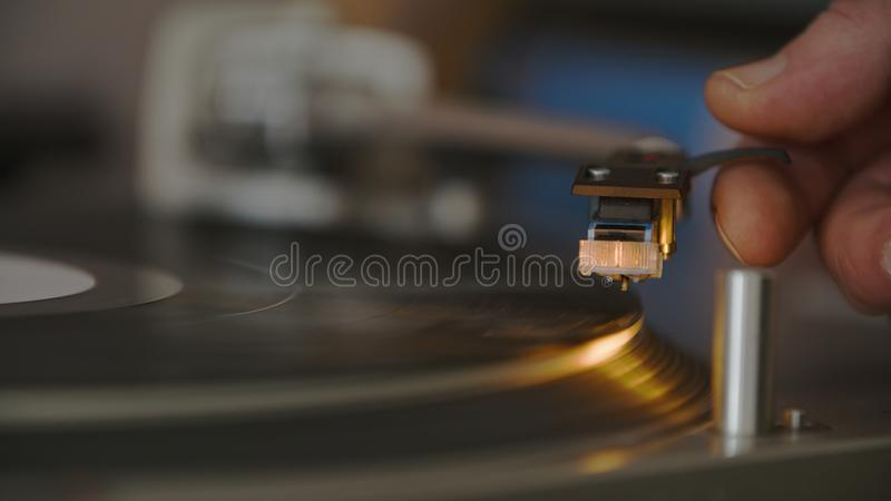Record Player Needle Set By Hand To Play royalty free stock photography