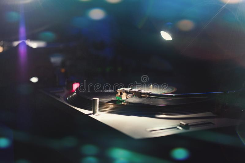 Record player  plays 45 rpm vinyl in vintage 80s dance club stock image