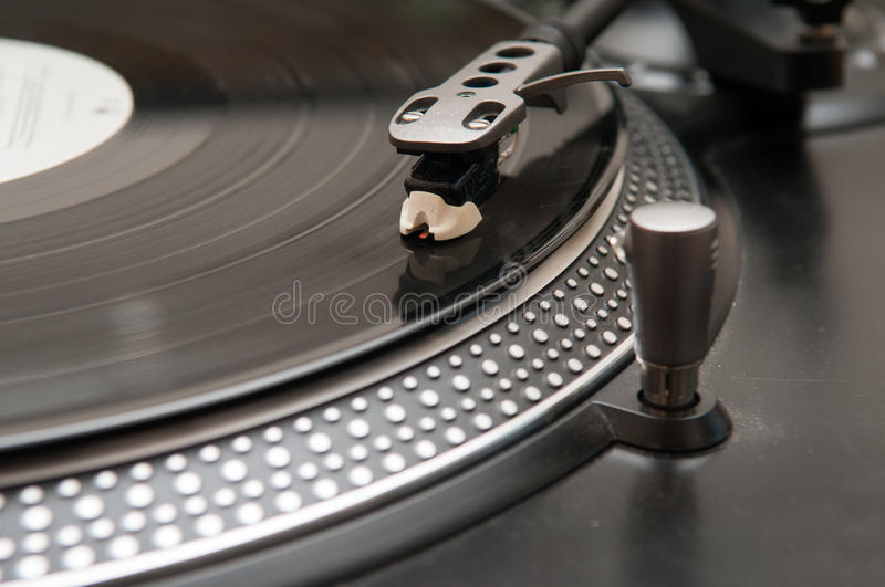 Record on a turntable stock photo