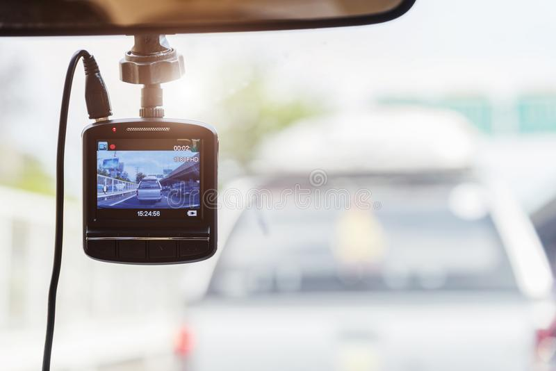 Recorder camera in front of car for safety on the road. Recorder camera in front of car for safety on the road with free copy space for text stock images