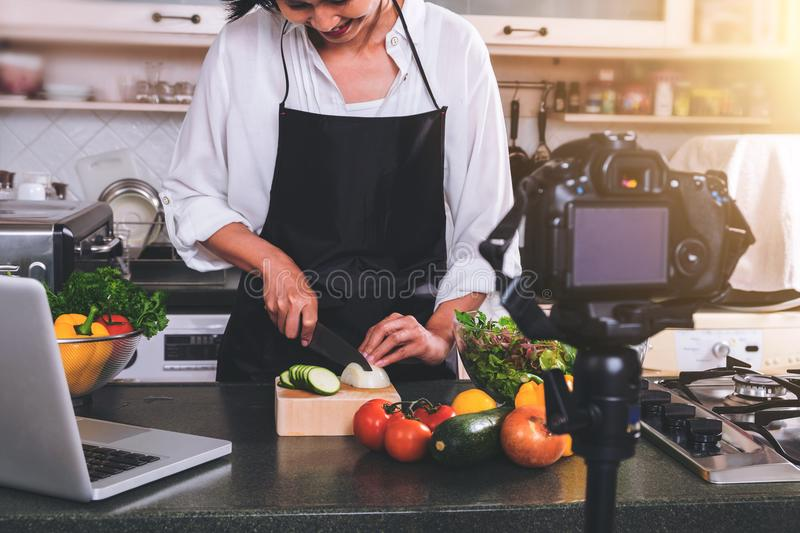 Recording of making cook, woman hand cutting onion on chopping w royalty free stock images