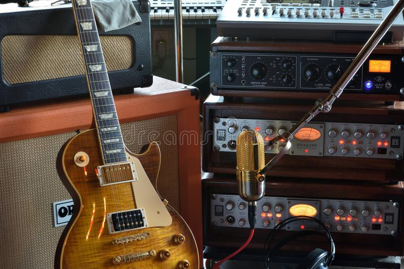 `The Recording Musician` Studio Stock Photo. Project studio stock photo. Features vacuum tube preamplifiers, digital DAW, Electric Guitar, Keyboard and Tube stock images