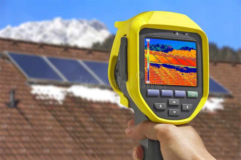 Recording Solar Panels with Thermal Camera. Recording Photovoltaic Solar Panels on the roof House With Thermal Camera stock image