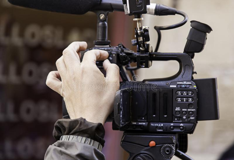 Recording with video camera. Detail of a video report, journalism stock photos