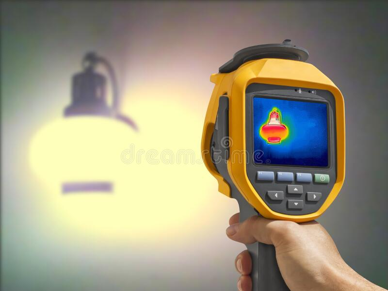 Recording whit Thermal camera, Lighted classic lamp stock image