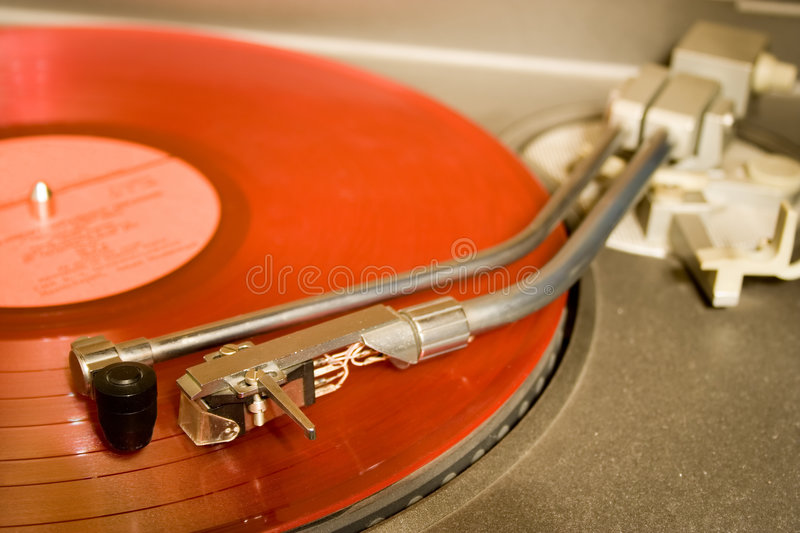 Recordplayer with red lp record. S stock photo