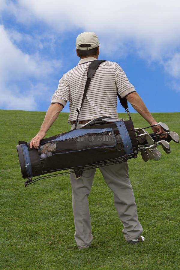 Recorriendo el campo de golf imágenes de archivo libres de regalías