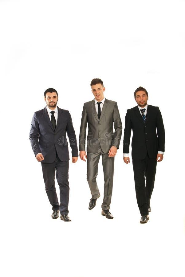 Recorriendo tres hombres de negocios imagen de archivo