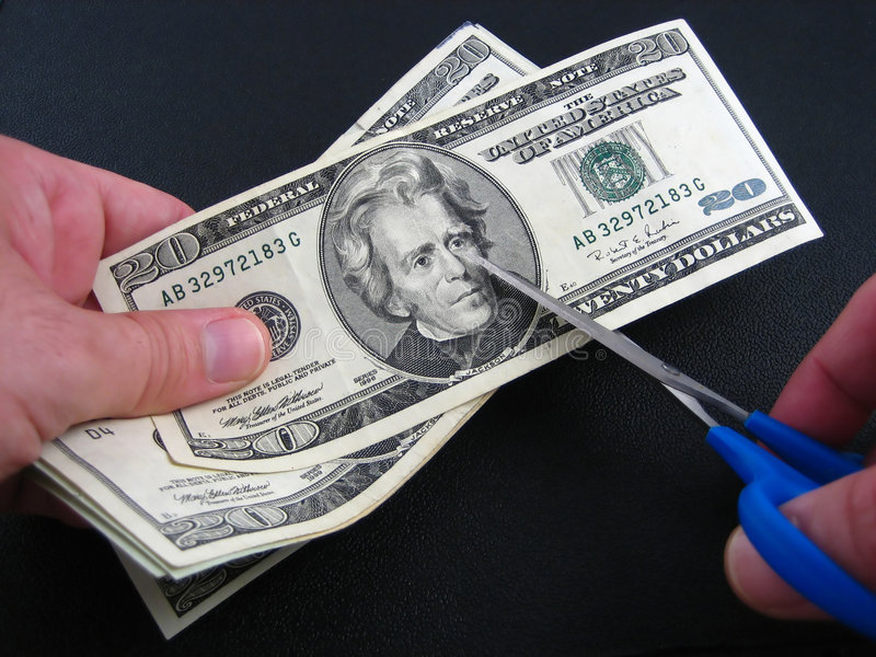 Recortes presupuestarios e impuestos fotografía de archivo libre de regalías