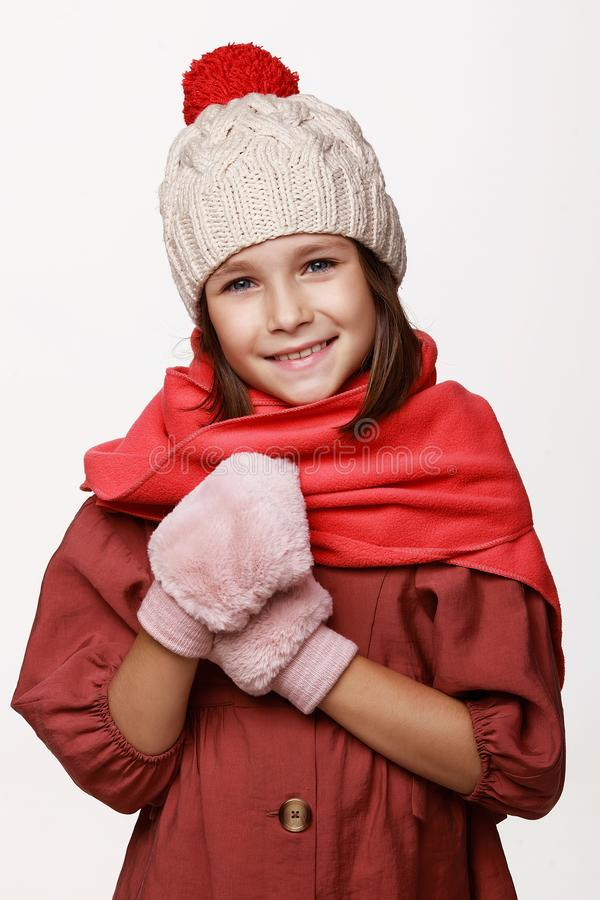 The recovering laughing girl in a jacket, a cap, gloves, a disease, cold, flu, winter, fall. Immunity. On a white background in studio stock images