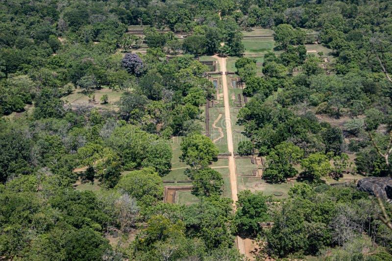 Recreated paths of formal palace gardens  below the Lion Rock. Sri lanka, Sigyriya - Sept 2015: Recreated paths of formal palace gardens  below the Lion Rock royalty free stock image