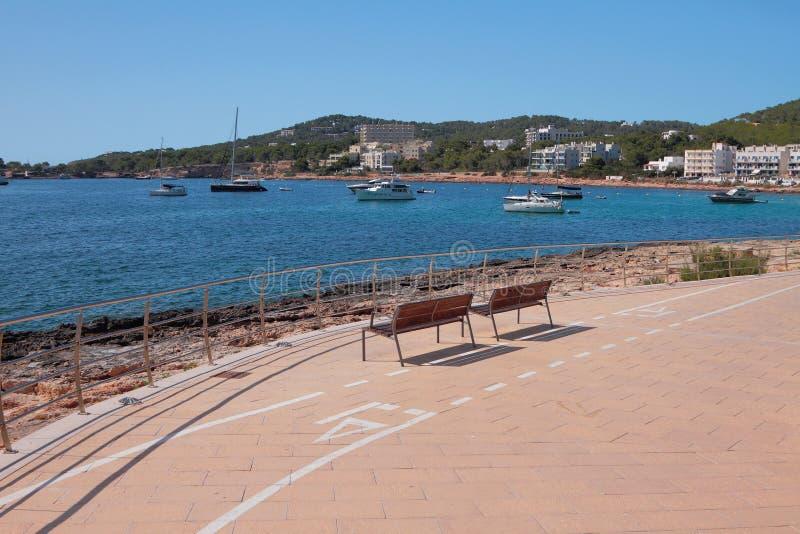 Recreation area overlooking bay and parking of yachts. San Antonio, Ibiza, Spain. 05-07-2017 stock image