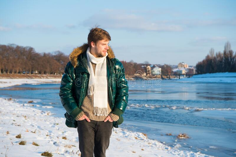 Recreation concept. Active leisure. Man traveling in winter. Warm clothes for cold season. Winter fashion. Winter stock image