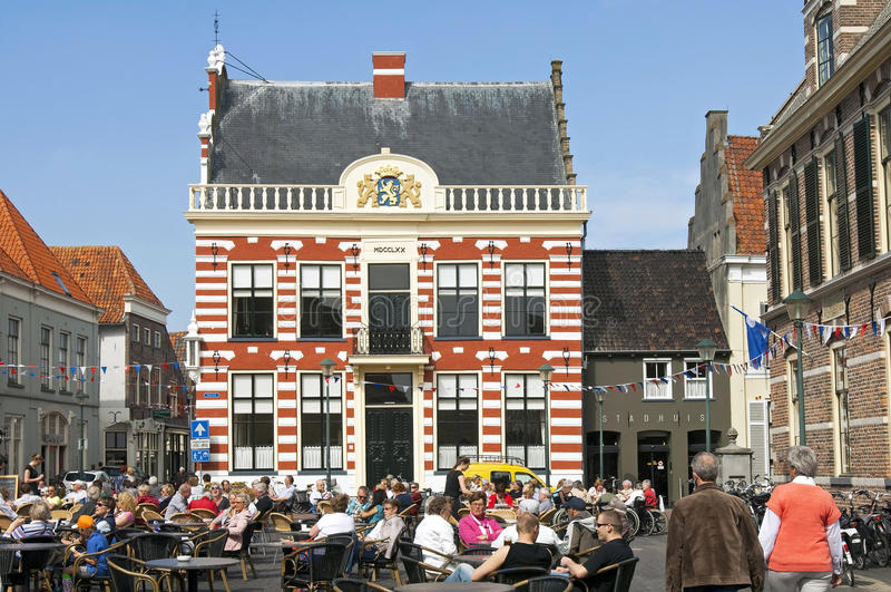 Recreation on terrace on Market with city hall Hattem royalty free stock images