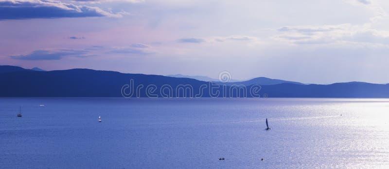 Recreational boating on Lake Champlain in Burlington, Vermont, USA at dusk stock photography