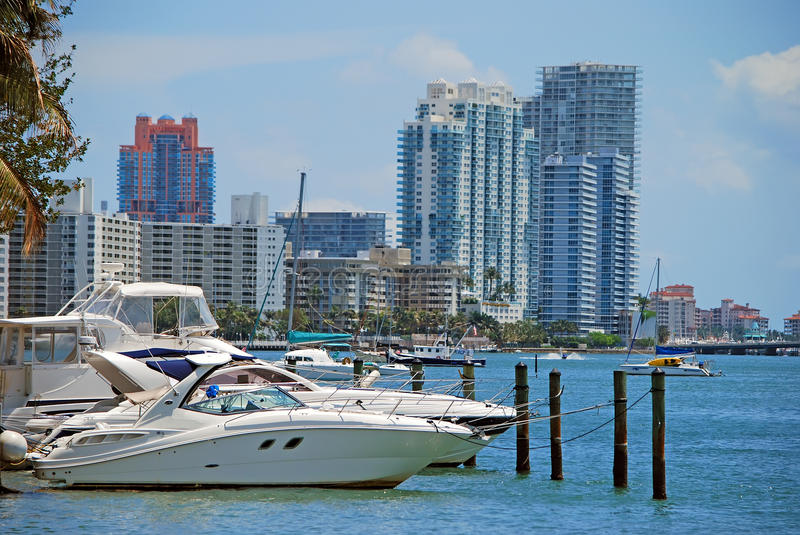 Recreational Boats and Luxury Condos stock images