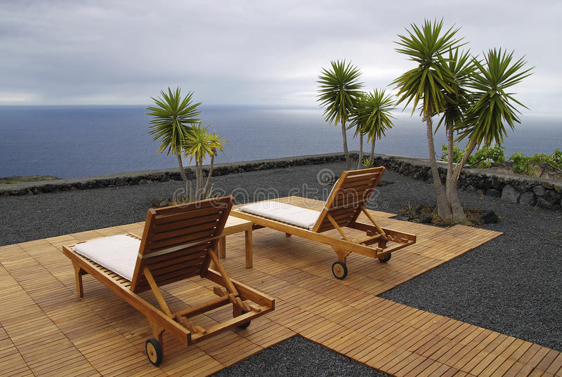Recreational chair with ocean view stock image