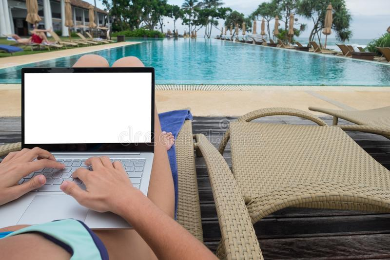 Recreational entrepreneur. Man with laptop in the morning on the beach working royalty free stock photos