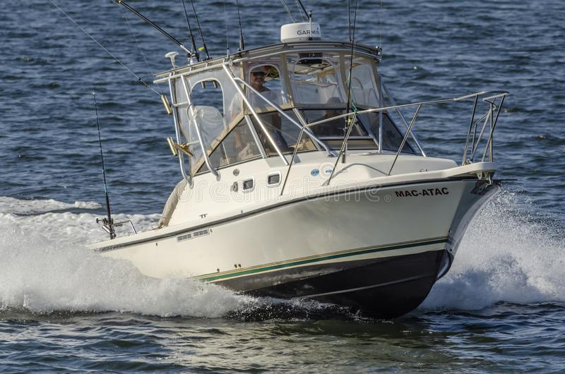 Recreational fishing boat Mac-Atac returning from trip royalty free stock photo