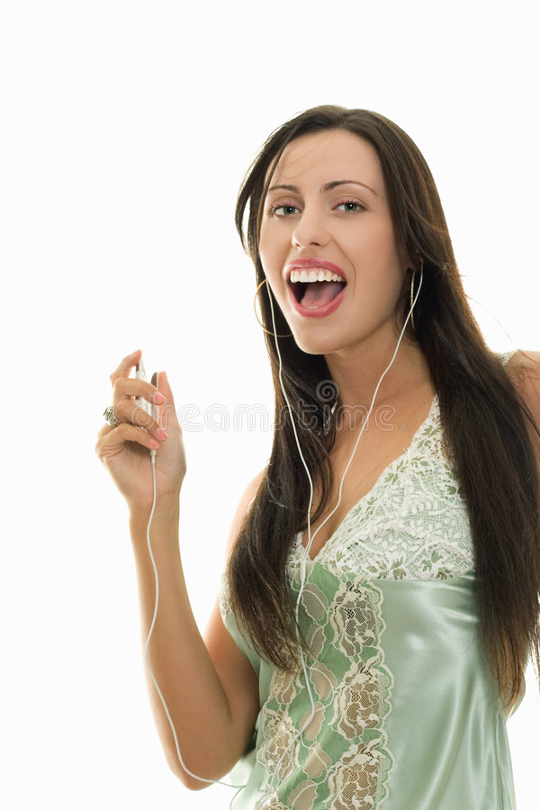 Recreational run woman with music player stock photo